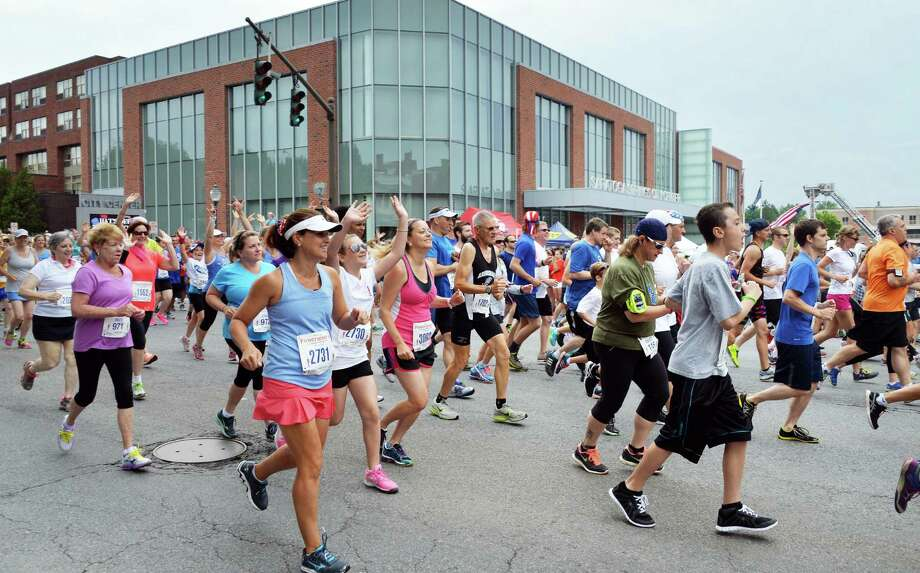 Thousands of runners begin the 8th annual OFirecracker 4O Road Race Friday July 4, 2014, in Saratoga Springs, NY.  (John Carl D'Annibale / Times Union) Photo: John Carl D'Annibale / 00027594A
