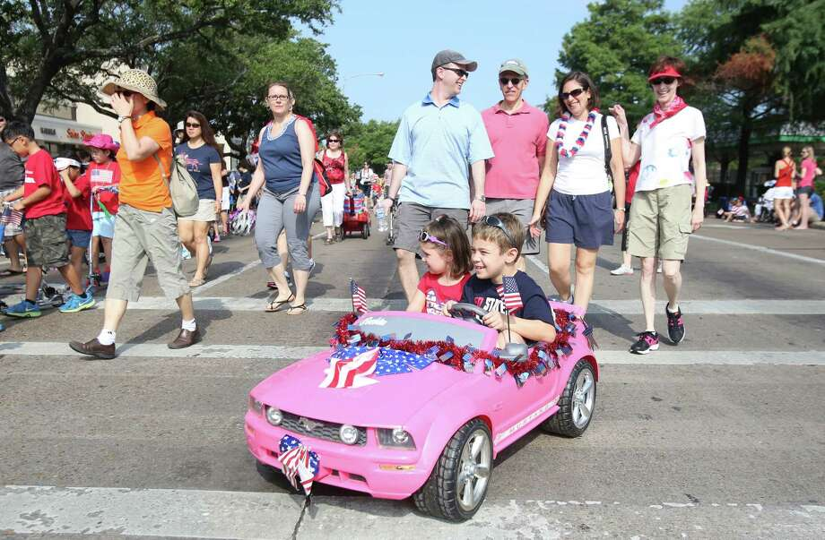 Joshua and Naomi Block star in the Kids Parade which kicks-off the Bellaire Fourth of July Parade where hundreds of people gathered to celebrate on July 4, 2014, in Houston, Tx. Photo: Mayra Beltran, Houston Chronicle / © 2014 Houston Chronicle