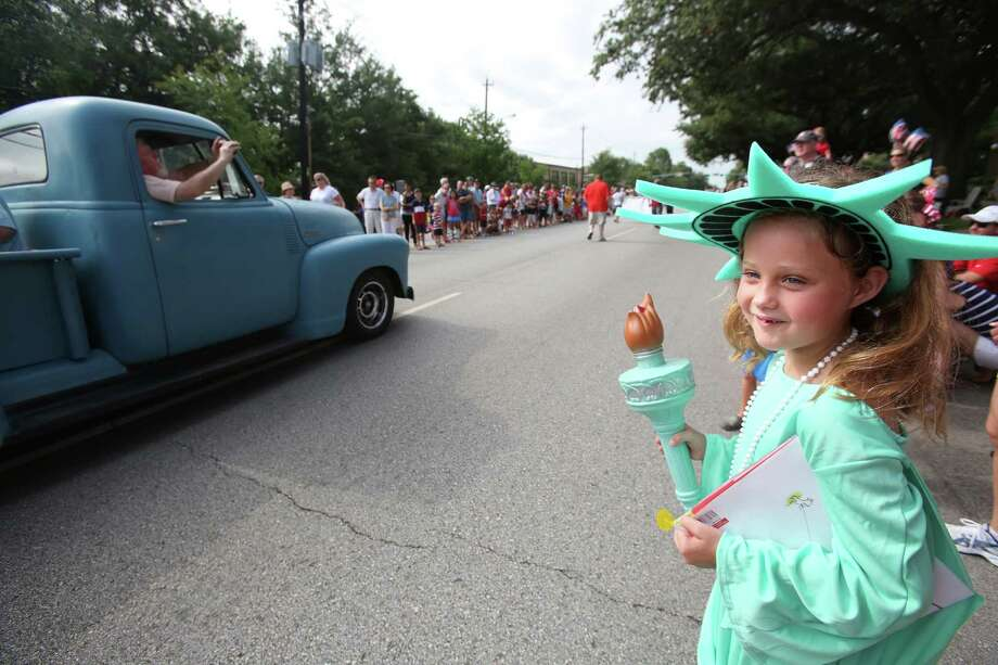 Amanda Lee Huttenback, 8, enjoys the Bellaire Fourth of July Parade where hundreds of people gathered to celebrate on July 4, 2014, in Houston, Tx. Photo: Mayra Beltran, Houston Chronicle / © 2014 Houston Chronicle