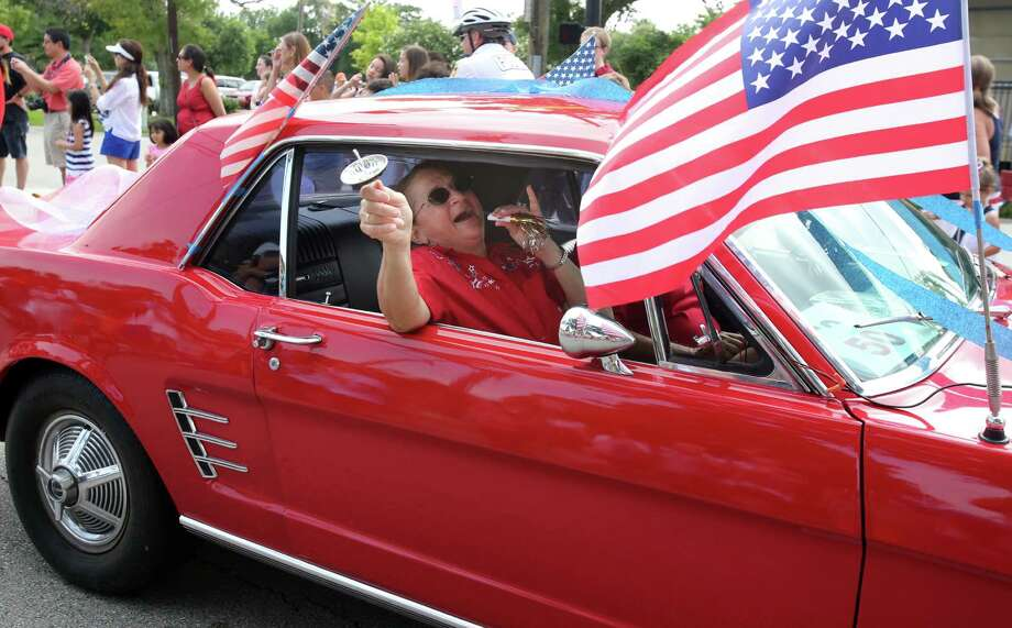 Classic cars parade down Rice Ave. during the Bellaire Fourth of July Parade where hundreds of people gathered to celebrate on July 4, 2014, in Houston, Tx. Photo: Mayra Beltran, Houston Chronicle / © 2014 Houston Chronicle