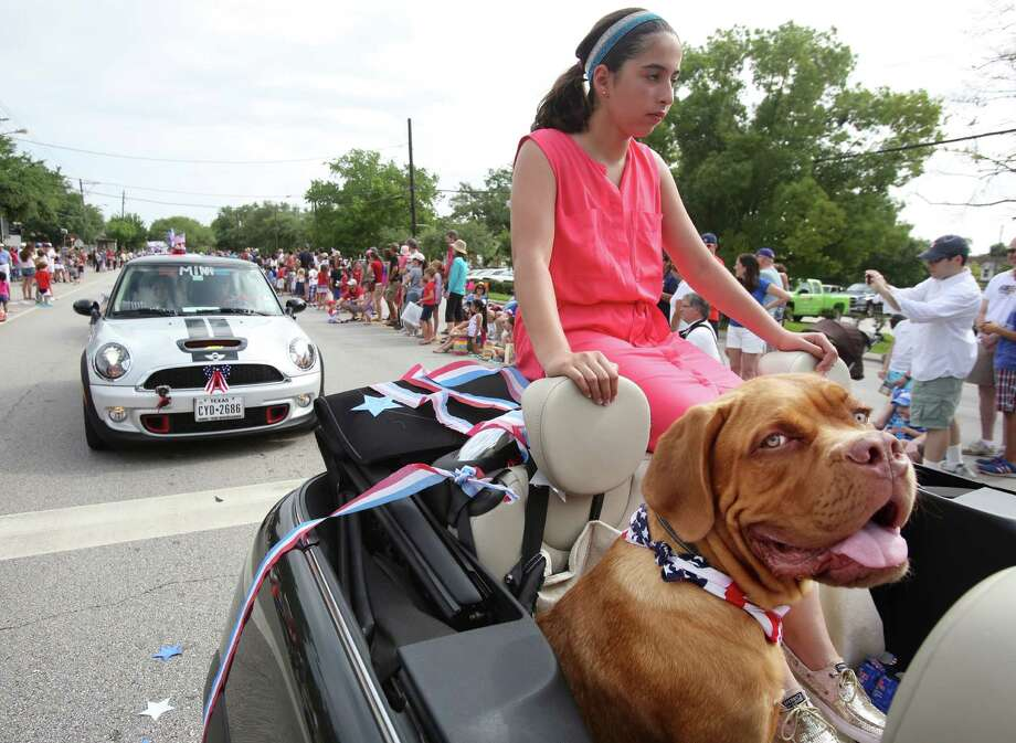 Reem Kazzaz and 'Chief' participate in the Bellaire Fourth of July Parade where hundreds of people gathered to celebrate on July 4, 2014, in Houston, Tx. Photo: Mayra Beltran, Houston Chronicle / © 2014 Houston Chronicle