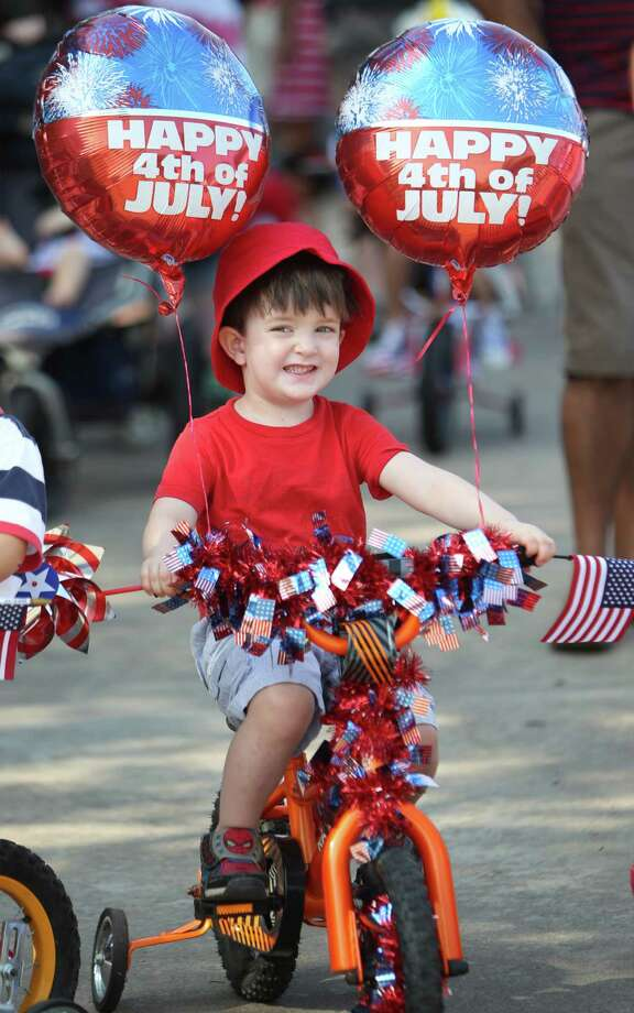 Fionn Quinlan smiles at the start of the Kid Parade which kicks-off the Bellaire Fourth of July Parade where hundreds of people gathered to celebrate on July 4, 2014, in Houston, Tx. Photo: Mayra Beltran, Houston Chronicle / © 2014 Houston Chronicle