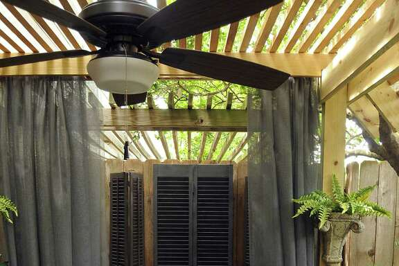 Margaret Shilstone hung fiberglass screen as curtains to soften a patio seating area. (Dave Rossman photo)