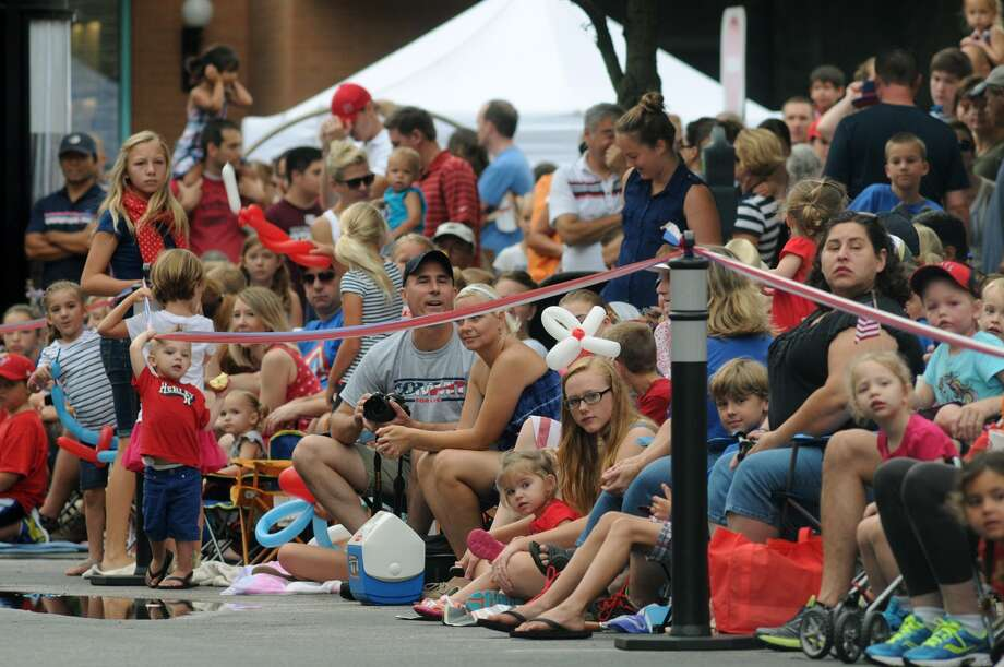 Parade-goers line the sidewalk of Market Street in The Woodlands for the 39th Annual South Montgomery County 4th of July Parade on Friday. Photo: Jerry Baker, For The Chronicle