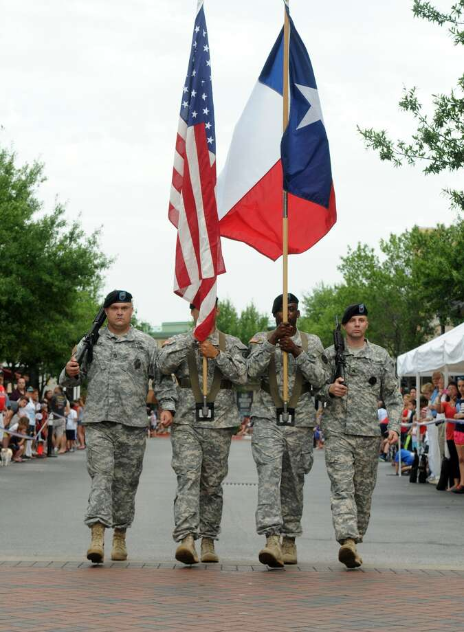 The Team 21 Color Guard from C Comapany of the Texas Air National Guard, including SFC Michael Daniecki, from left, SSG Victor Cruz, SSG Larry Joseph, and Sgt Justin Grandmont lead the 39th Annual South Montgomery County 4th of July Parade in Market Street in The Woodlands on Friday. Photo: Jerry Baker, For The Chronicle