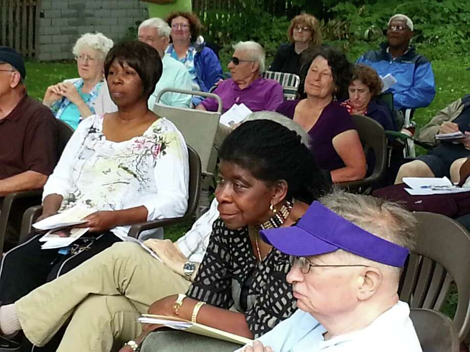 Alice Green, center, sits among those attending the Underground Railroad History Project's July 4th Oration in the backyard of the Stephen and Harriet Myers Residence on Livingston Avenue on Friday. (Dennis Yusko / Times Union)