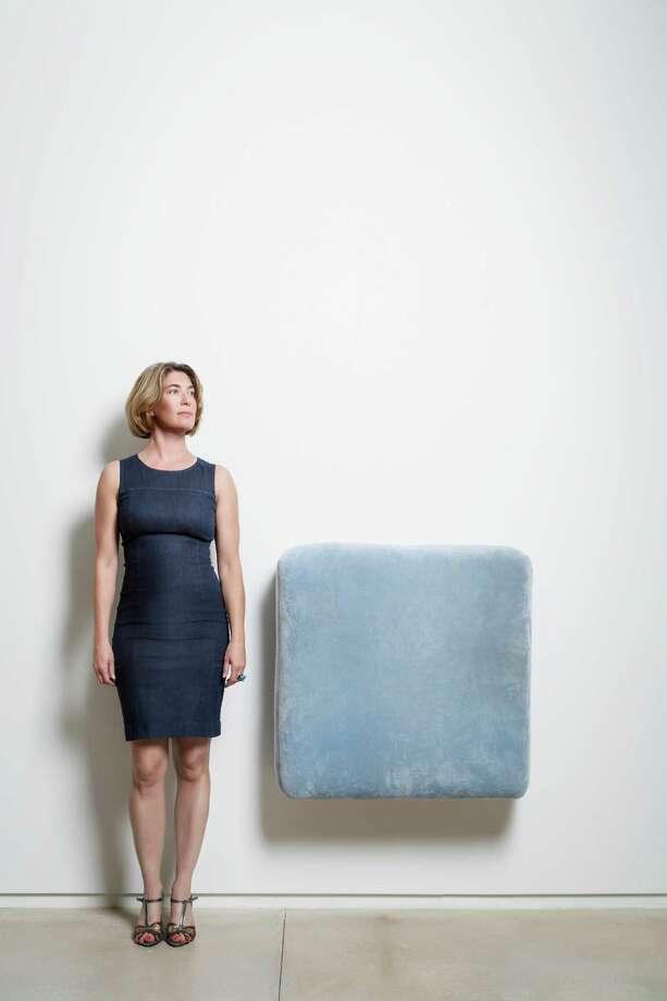 Claudia Schmuckli, Director and Chief Curator at Blaffer Art Museum, University of Houston, in a blue sheath power dress. Photo: Michael Paulsen, Staff / © 2013 Houston Chronicle