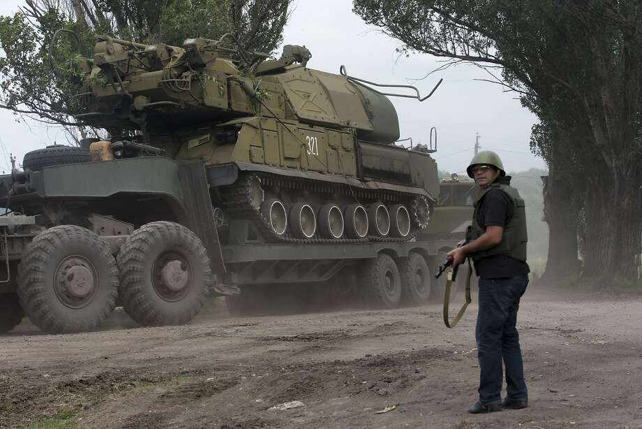 Ukrainian government forces maneuver antiaircraft missile launchers being transported from Slavyansk, eastern Ukraine, as they press their offensive, dimming prospects for a truce. Photo: Dmitry Lovetsky, Associated Press