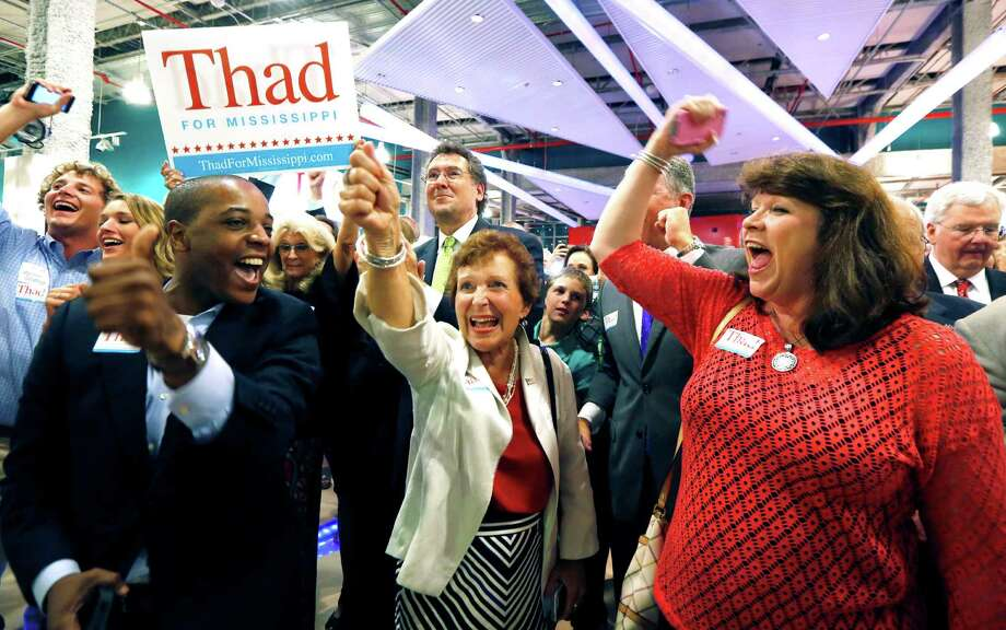 FILE - In this June 24, 2014 file photo, supporters of Sen. Thad Cochran, R-Miss., break into cheer as he is declared the winner in the primary runoff for the GOP nomination for U.S. Senate at his victory party in Jackson, Miss. Blacks turned out for Cochran against a tea party favorite, and winning means paying more attention to a constituency that includes thousands of black voters, who across the South are calling for the renewal of the Voting Rights Act. (AP Photo/Rogelio V. Solis, File) Photo: Rogelio V. Solis, STF / AP