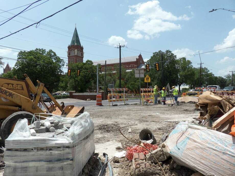 Construction materials rest on Broadway by a crew working to complete the drainage and traffic flow improvements on Broadway near Hildebrand on July 3, 2014. The work has been ongoing for almost a year and a half. Photo: Billy Calzada, San Antonio Express-News / San Antonio Express-News