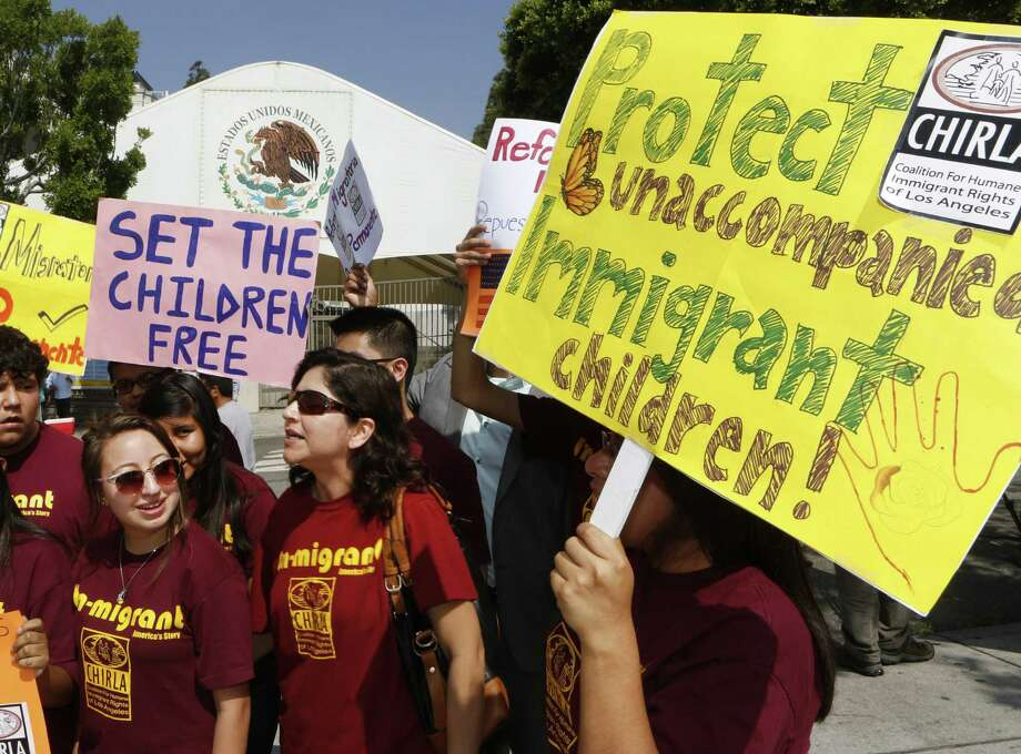 Activists with Coalition for Humane Immigrant Rights of Los Angeles  demand the Mexican government take more measures to protect  unaccompanied minors and families. Photo: Damian Dovarganes / Associated Press / AP