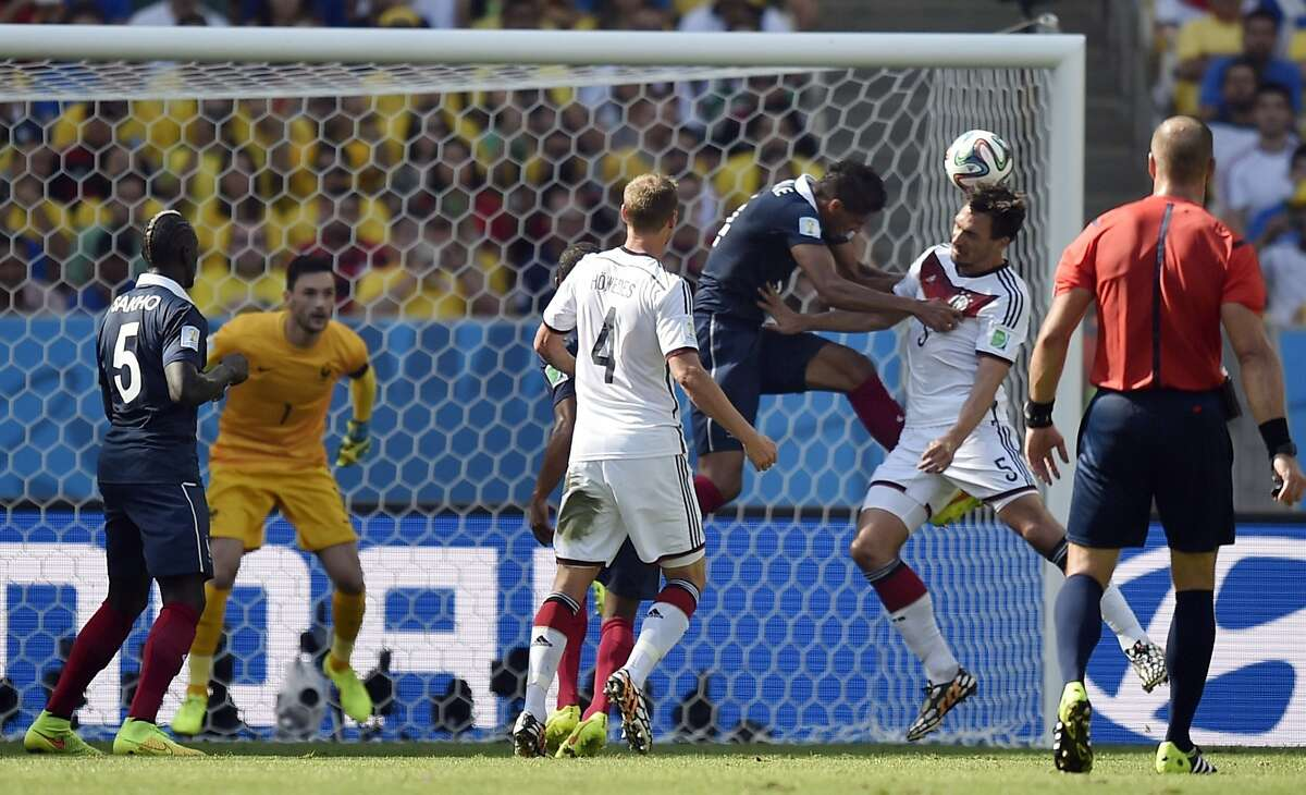 Germany's Mats Hummels, second right, scores the opening goal during the World Cup quarterfinal soccer match between Germany and France at the Maracana Stadium in Rio de Janeiro, Brazil, Friday, July 4, 2014. (AP Photo/Martin Meissner)