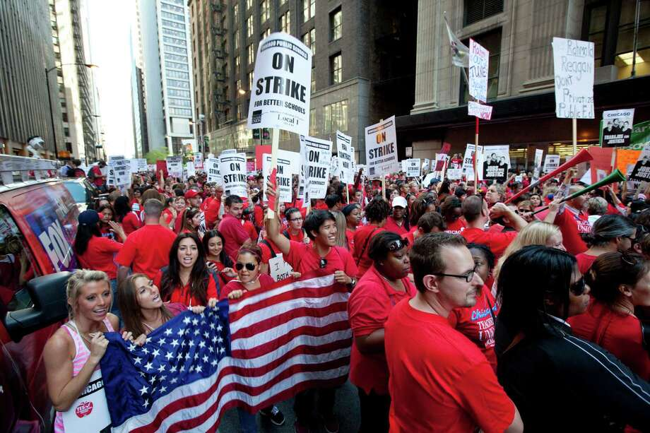 FILE - This Sept. 10, 2012, file photo shows thousands of public school teachers rallying outside the Chicago Public Schools district headquarters on the first day of strike action over teachers' contracts in Chicago. A majority of union members today now have ties to a government entity at the federal, state or local levels. The typical union worker now is more likely to be an educator, office worker or food or service industry employee rather than a construction worker, autoworker, electrician or mechanic, with far more women than men among the ranks. Overall, 11.3 percent of U.S. wage and salary workers are unionized, down from a peak of 35 percent during the mid-1950s.  (AP Photo/Sitthixay Ditthavong, File) ORG XMIT: WX601 Photo: Sitthixay Ditthavong / AP
