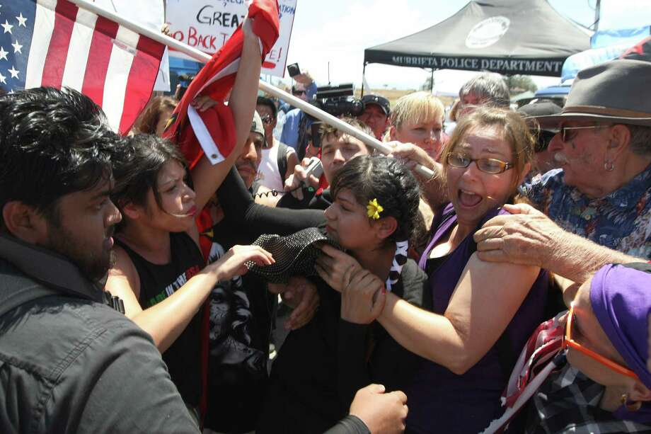 A demonstration Friday at the Border Patrol station in Murrieta, Calif., turned into a shouting and shoving match between protesters and supporters of the undocumented migrants, mostly women and minors, bused in for processing. Photo: David McNew, Stringer / 2014 Getty Images