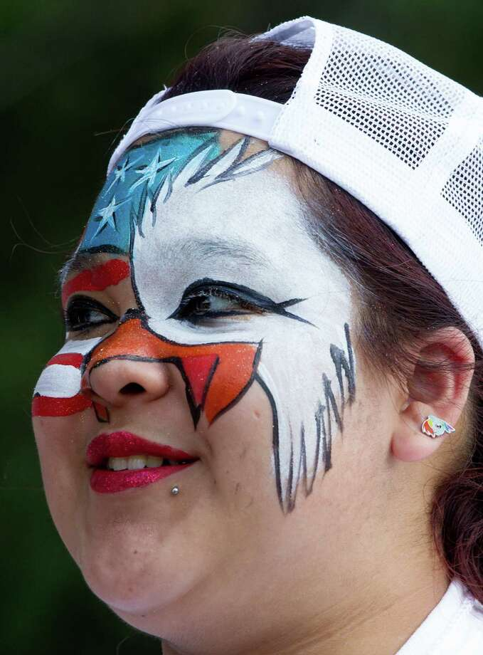Dominique Zapata, 18, has her face painted as a patriotic eagle during the Freedom Over Texas Fourth of July celebration at Eleanor Tinsley Park on Friday, July 4, 2014, in Houston. Photo: J. Patric Schneider, For The Chronicle / © 2014 Houston Chronicle