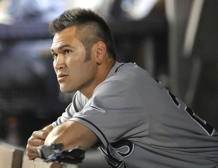 Former New York Yankee Johnny Damon, now with the Tampa Bay Rays, watches the baseball game from the dugout on Thursday, July 7, 2011, at Yankee Stadium in New York. Tampa Bay won 5-1. Photo: Kathy Kmonicek, AP