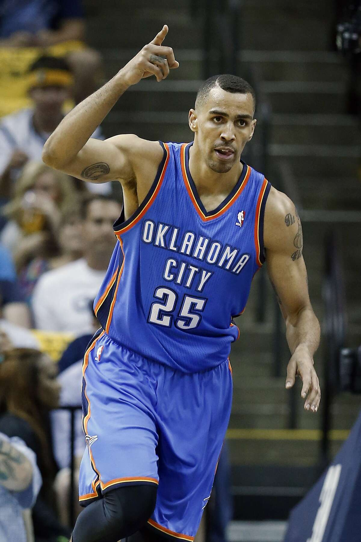 FILE - In this April 24, 2014 file photo, Oklahoma City Thunder guard Thabo Sefolosha celebrates after scoring against the Memphis Grizzlies in the first half of Game 3 of an opening-round NBA basketball playoff series game in Memphis, Tenn. The Atlanta Hawks have reached an agreement with small forward Thabo Sefolosha on a deal that leaves the team sufficient salary cap room for additional offseason moves. The Hawks and Sefolosha have agreed to a three-year, $12 million contract, a person with knowledge of the deal said Friday, July 4, 2014. The person spoke to The Associated Press on condition of anonymity because teams can't officially sign free agents until the NBA's moratorium on deals is lifted on Thursday. (AP Photo/Mark Humphrey, File)
