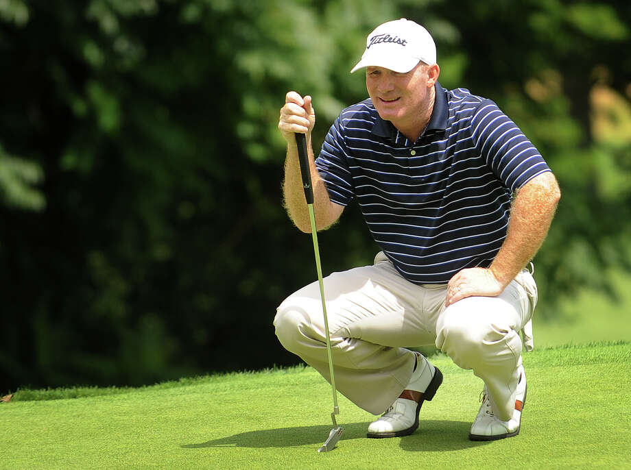 Frank Bensel of Danbury lines up his putt on the eleventh green during the third round of the Connecticut Open golf tournament at Brooklawn Country Club in Fairfield on Wednesday, July 27, 2011. Photo: Brian A. Pounds, ST / Connecticut Post