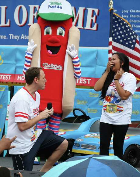 Com-petitive eater Joey Chestnut proposes to his girlfriend and fellow competitor Neslie Ricasa before the Nathan's Famous Fourth of July Inter-national Hot Dog Eating contest at Coney Island on Friday. Chestnut won by finishing 61 hot dogs. Photo: John Minchillo, FRE / FR170537 AP