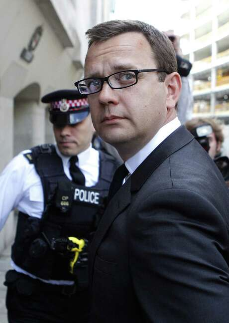 Andy Coulson, a former top aide to British Prime Minister David Cameron, arrives at the Old Bailey in central London, ahead of his expected sentencing in the phone-hacking trial, on July 4, 2014. Coulson was jailed for 18 months on Friday for his role in the phone-hacking scandal that brought down Rupert Murdoch's News of the World tabloid.  AFP PHOTO / CYRIL VILLEMAINCYRIL VILLEMAIN/AFP/Getty Images Photo: CYRIL VILLEMAIN, Stringer / Cyril Villemain