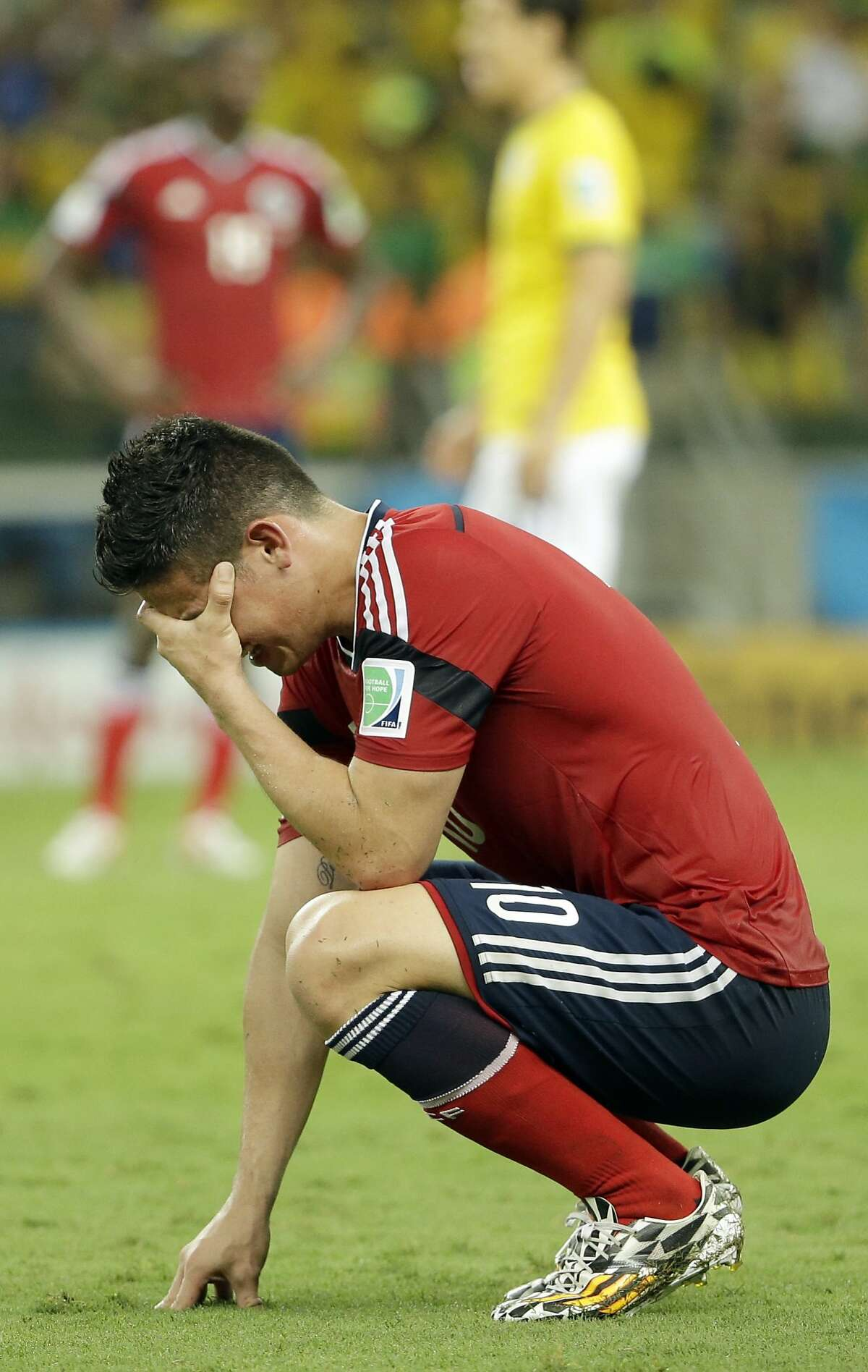 Colombia's James Rodriguez reacts at the end of the World Cup quarterfinal soccer match between Brazil and Colombia at the Arena Castelao in Fortaleza, Brazil, Friday, July 4, 2014. Brazil won 2-1 to reach the semifinals.(AP Photo/Hassan Ammar)