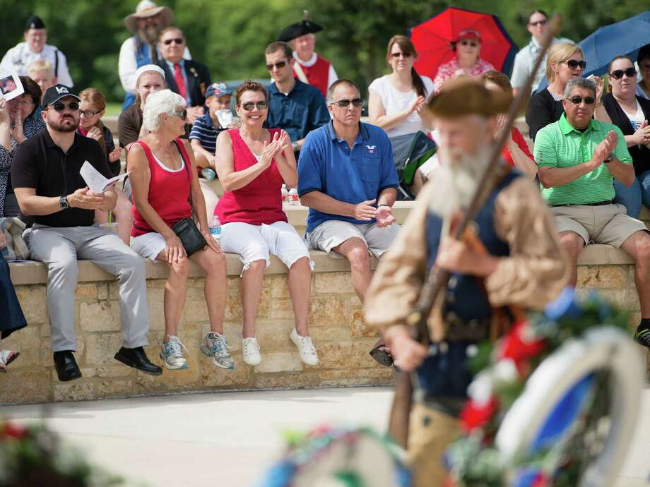 Spectators enjoy an Independence Day ceremony on Friday, July 4, 2014, at Fort Sam Houston National Cemetery in San Antonio. (Darren Abate/For the Express-News) Photo: Darren Abate, Darren Abate/Express-News / DA Media, LLC