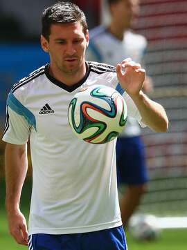 BRASILIA, BRAZIL - JULY 04:  Lionel Messi of Argentina dribbles the ball during a training session at Estadio Nacional on July 4, 2014 in Brasilia, Brazil.  (Photo by Ronald Martinez/Getty Images)