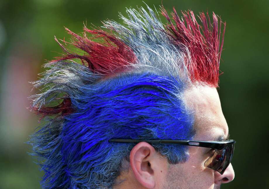 Ramiro Martinez shows his patriotism by having his hair colored red, white, and blue during the Freedom Over Texas Fourth of July celebration at Eleanor Tinsley Park on Friday, July 4, 2014, in Houston. Photo: J. Patric Schneider, For The Chronicle / © 2014 Houston Chronicle