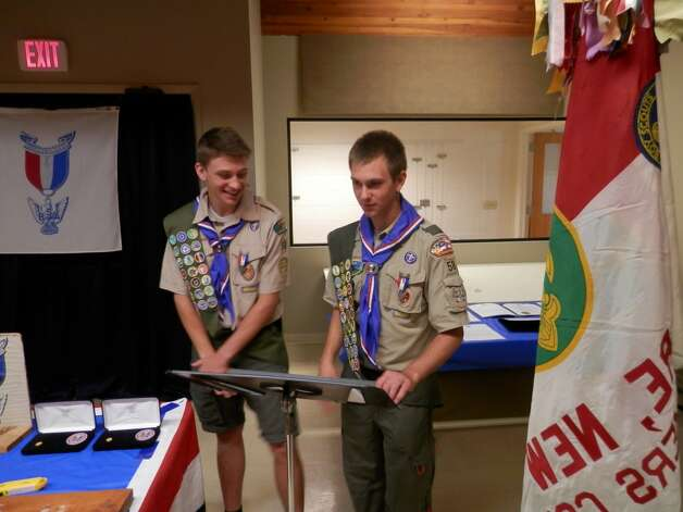 Michael Collier, left, and Marcus Harazin speak at their recent Eagle Scout Court of Honor at St. Stephen?s Church in Delmar. Michael Collier?s Eagle Scout project involved working with the town of Putnam Station officials to erect a flag pole and memorial to honor veterans at the town public beach and boat launch on Lake George. Harazin worked with the Mohawk Hudson Land Conservancy to plan and supervise development of a new trail section at the Keleher Preserve, allowing access to a scenic overlook of the Helderberg escarpment. They are members of Troop 58 in Elsmere sponsored by the Nathaniel Blanchard American Legion Post. (Submitted photo)