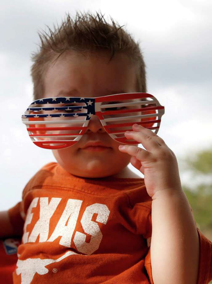 Victor Calderon, 10-months wears American flag glasses during the 2014 Southwest Airlines Freedom over Texas at Eleanor Tinsley and Sam Houston Parks, Friday, July 4, 2014, in Houston. Photo: Karen Warren, Houston Chronicle / © 2014 Houston Chronicle