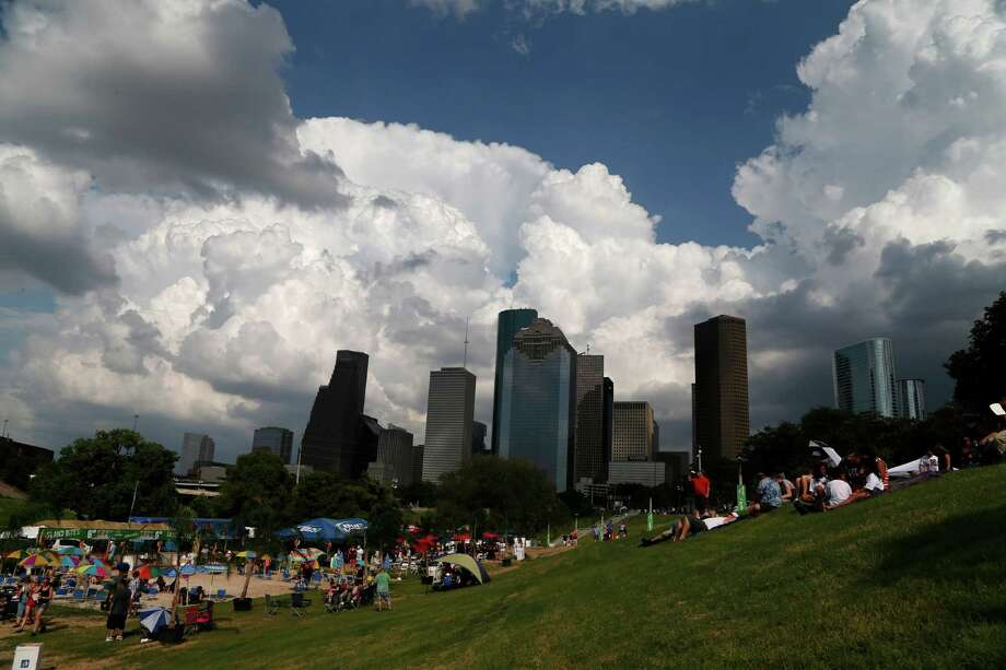 Skies darken over downtown during the 2014 Southwest Airlines Freedom over Texas at Eleanor Tinsley and Sam Houston Parks, Friday, July 4, 2014, in Houston. Photo: Karen Warren, Houston Chronicle / © 2014 Houston Chronicle
