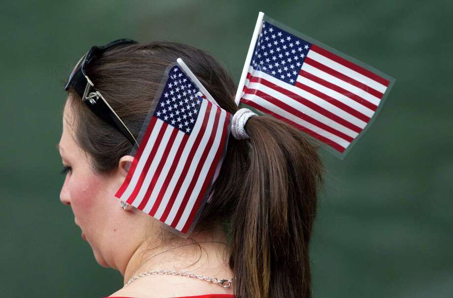 A lady wears two American Flags in her hair during the Freedom Over Texas Fourth of July celebration at Eleanor Tinsley Park on Friday, July 4, 2014, in Houston. Photo: J. Patric Schneider, For The Chronicle / © 2014 Houston Chronicle