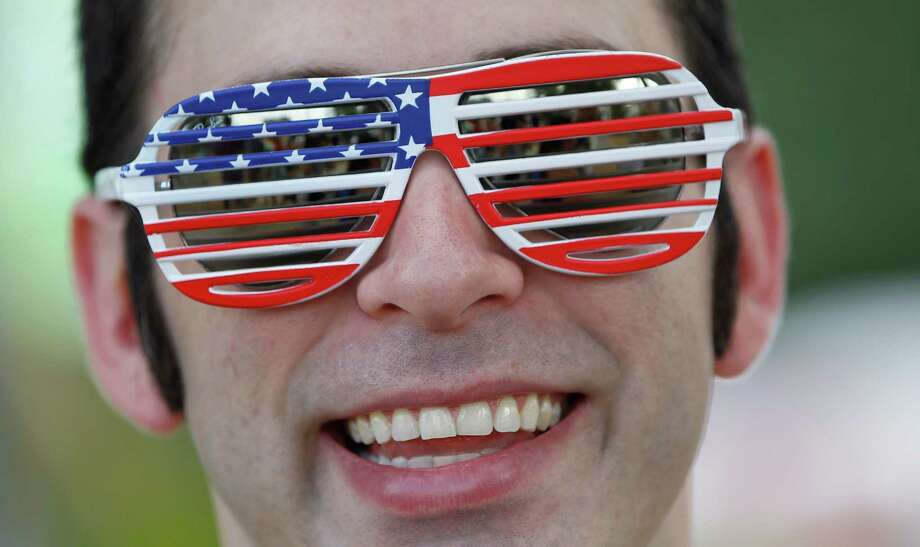 Derek Lanphier, of Houston, sports a pair of American flag glasses during the 2014 Southwest Airlines Freedom over Texas at Eleanor Tinsley and Sam Houston Parks, Friday, July 4, 2014, in Houston. Photo: Karen Warren, Houston Chronicle / © 2014 Houston Chronicle