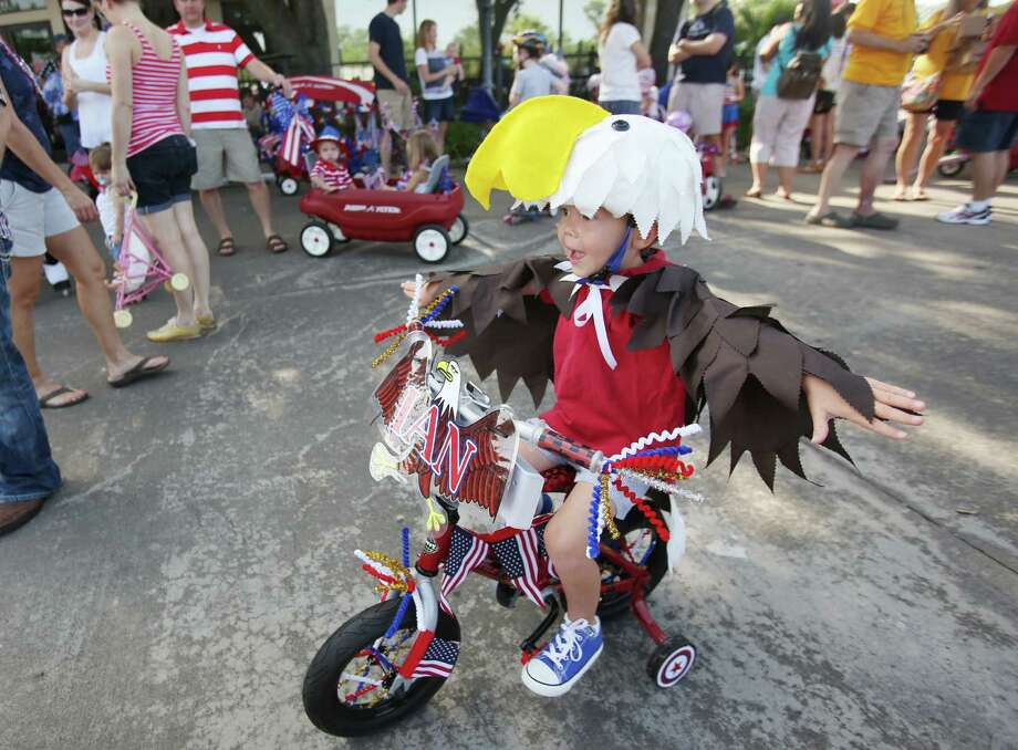 Ian Anderson, 4, is ready for The Kids Parade which starts the Bellaire Fourth of July Parade where hundreds of people gathered to celebrate on July 4, 2014, in Houston, Tx. Photo: Mayra Beltran, Houston Chronicle / © 2014 Houston Chronicle