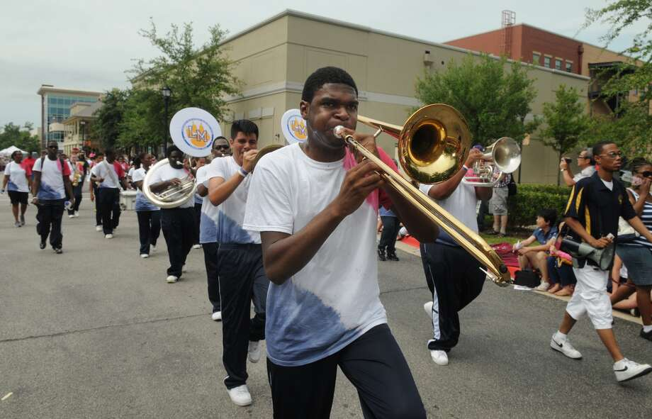 Brandon Stark, 16, a senior at La Marque High School and the Cougar Marching Band performs during the 39th Annual South Montgomery County 4th of July Parade in Market Street in The Woodlands on Friday. Photo: Jerry Baker, For The Chronicle