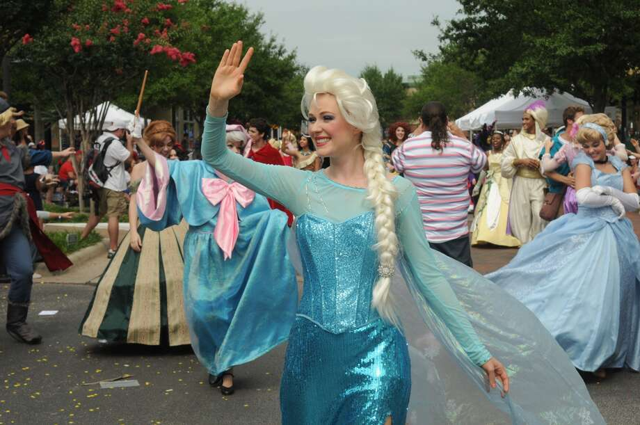 """Kristina Kennedy, 23, of Missouri City, as """"Elsa"""" from the movie """"Frozen"""", and a member of Fairy Tale Headquarters in Houston, waves to the crowd during the 39th Annual South Montgomery County 4th of July Parade in Market Street in The Woodlands on Friday. Photo: Jerry Baker, For The Chronicle"""