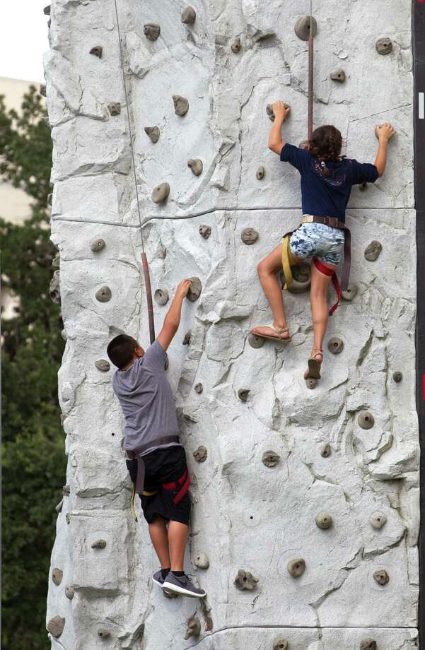 Kids enjoy climbing a wall during the Freedom Over Texas Fourth of July celebration at Eleanor Tinsley Park on Friday, July 4, 2014, in Houston. Photo: J. Patric Schneider, For The Chronicle / © 2014 Houston Chronicle
