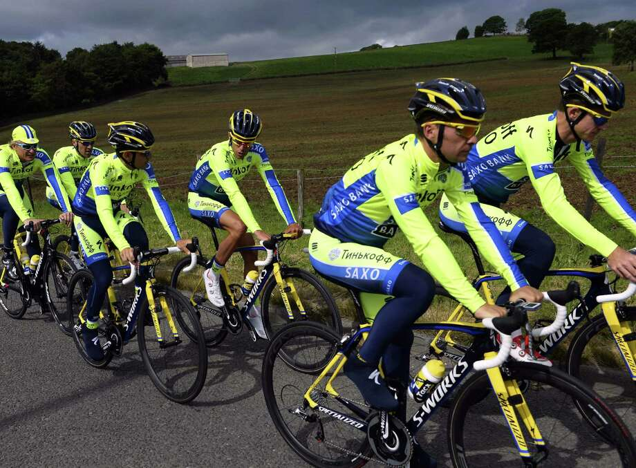 Russia's Tinkoff-Saxo cycling team, which features two-time champion Alberto Contador, trains in Leeds, England, before the start of today's Tour de France. Photo: Eric Feferberg / Getty Images / ERIC FEFERBERG