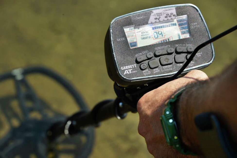 Steve Bell, a metal detector enthusiast who covers Saratoga and Lake George area for ringfinders.com, using a Garrett AT Pro metal detector in Saratoga Lake Thursday, July 3, 2014, in Saratoga Springs, N.Y. (John Carl D'Annibale / Times Union)