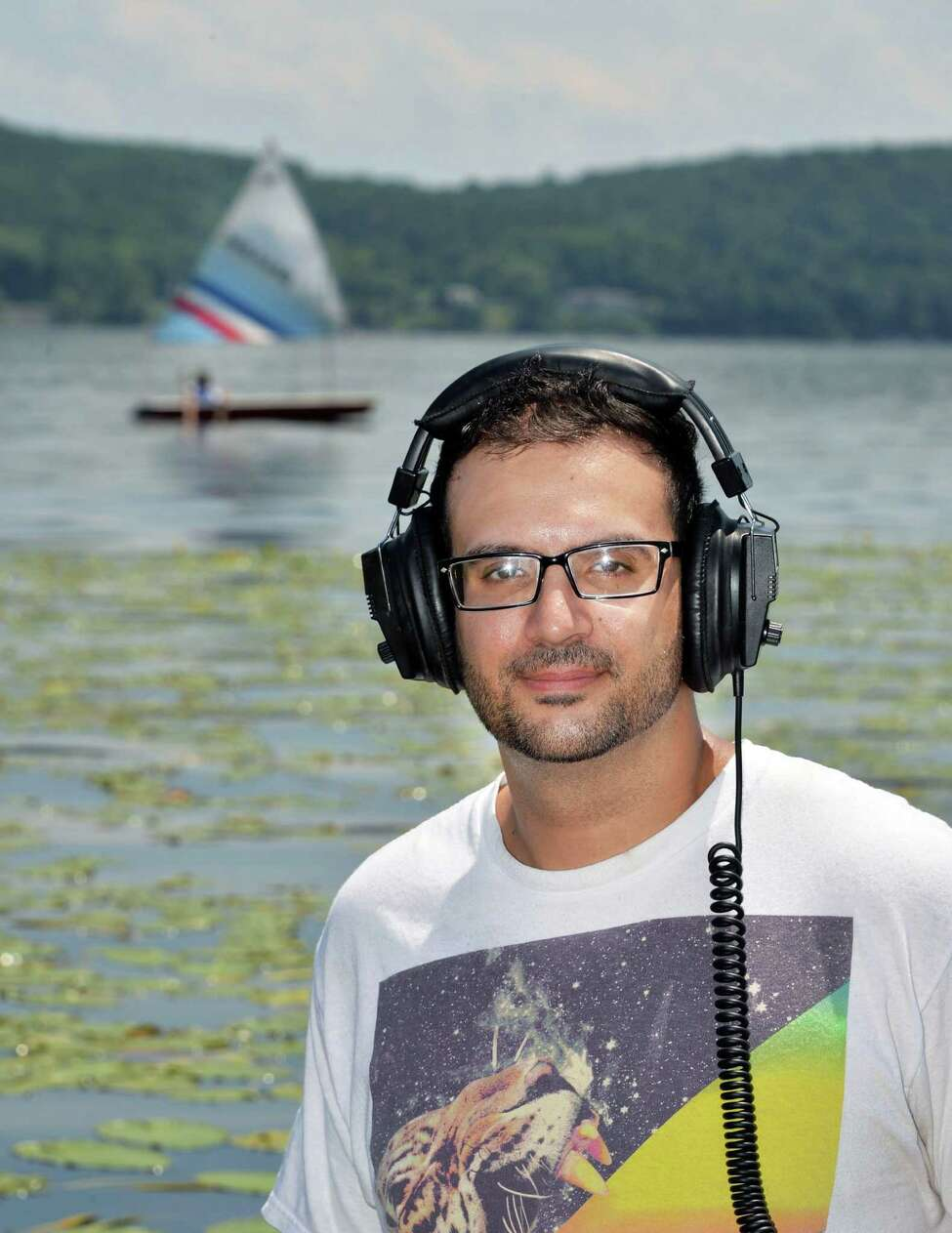 Steve Bell, a metal detector enthusiast who covers Saratoga and Lake George area for ringfinders.com, at Saratoga Lake Thursday, July 3, 2014, in Saratoga Springs, N.Y. (John Carl D'Annibale / Times Union)