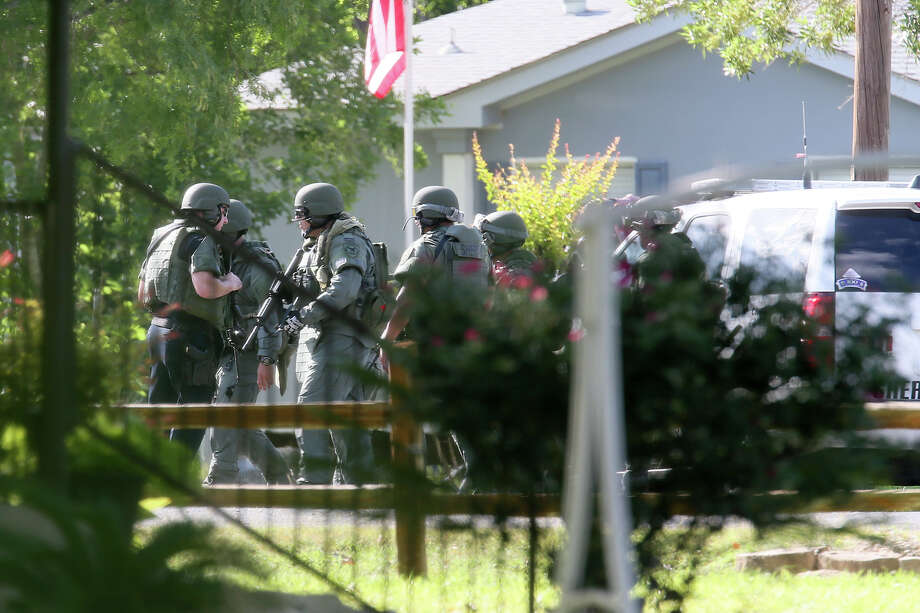 The Bexar County Sheriff's Office's SWAT team assembles outside a house in the 15400 block of Mesquite Trail on the city's far northwest side on July 4, 2014.  A 27-year-old male was shot in the face at approximately 3:30 and officers suspected that two suspects, a male and a female may have still been inside the home.  The found the home to be empty.  MARVIN PFEIFFER/ mpfeiffer@express-news.net Photo: MARVIN PFEIFFER, Marvin Pfeiffer/ Express-News / Express-News 2014