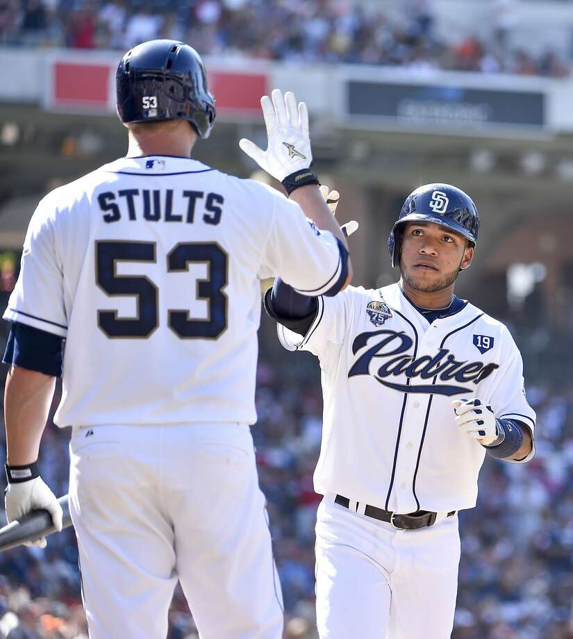 Alexi Amarista is greeted by Eric Stults after Amarista's homer in the third inning. Photo: Denis Poroy, Getty Images