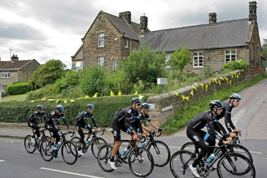 Britain's Christopher Froome, second left, rides with his Sky teammates during a training ahead of the Tour de France cycling race in Leeds, Britain, Friday, July 4, 2014. The Tour de France will start on Saturday July 5 in Leeds, and finishes in Paris on Sunday July 27. (AP Photo/Laurent Cipriani) ORG XMIT: PDJ103 Photo: Laurent Cipriani / AP