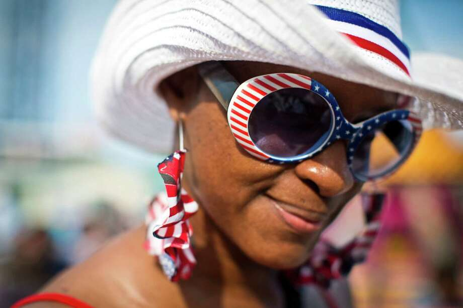 China O'Bryant of Houston takes advantage of the holiday to celebrate her pride for America, not only because is the Day of Independence, but also because of the World Cup 2014. This year is the first time she visits Kemah Boardswalk during the holiday. Friday, July 4, 2014, in Kemah. Photo: Marie D. De Jesus, Houston Chronicle / © 2014 Houston Chronicle