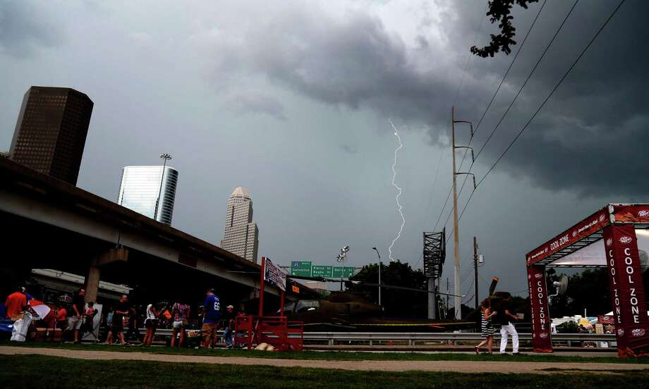 Lightning strikes above downtown during the 2014 Southwest Airlines Freedom over Texas at Eleanor Tinsley and Sam Houston Parks, Friday, July 4, 2014, in Houston. Photo: Karen Warren, Houston Chronicle / © 2014 Houston Chronicle