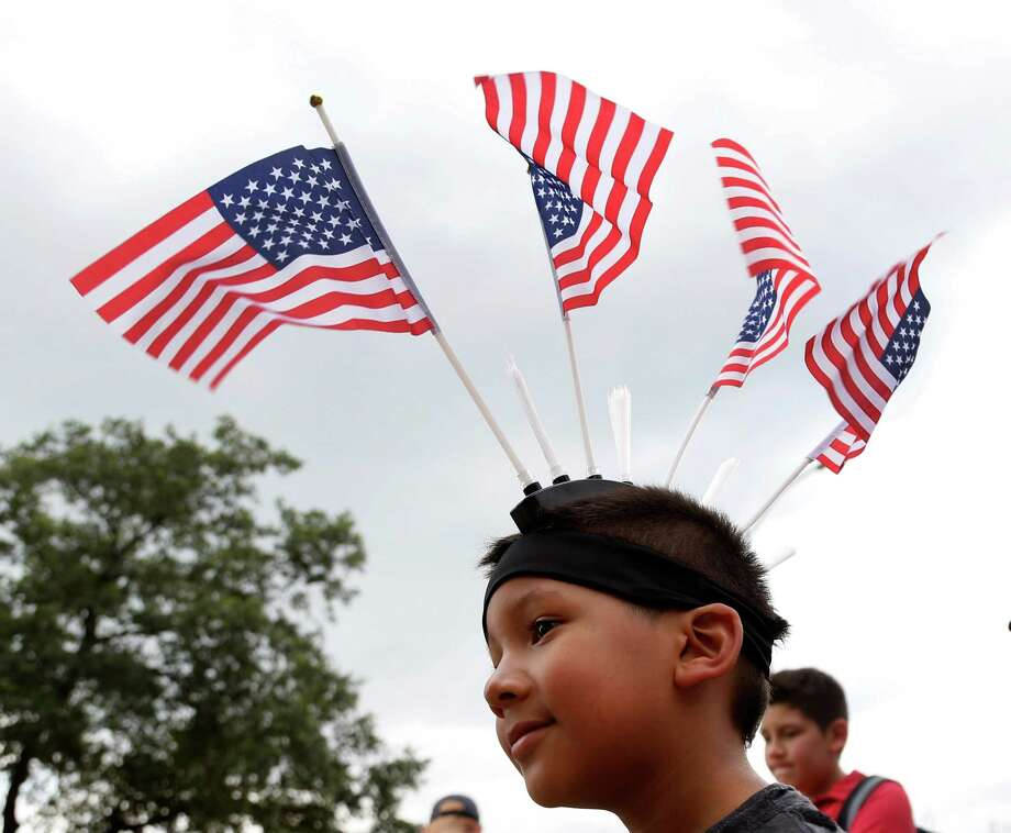 Ethan Urrutia, 7, wears a headband with four American flags on it during the 2014 Southwest Airlines Freedom over Texas at Eleanor Tinsley and Sam Houston Parks, Friday, July 4, 2014, in Houston. Photo: Karen Warren, Houston Chronicle / © 2014 Houston Chronicle