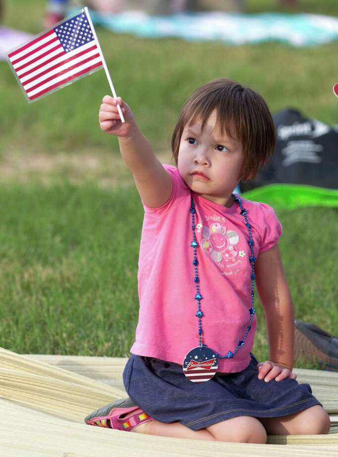 Dixie Sparrow, 3, waves her American Flag during the Freedom Over Texas Fourth of July celebration at Eleanor Tinsley Park on Friday, July 4, 2014, in Houston. Photo: J. Patric Schneider, For The Chronicle / © 2014 Houston Chronicle