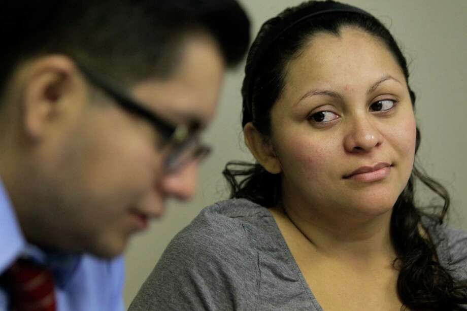 Gladys Lopez, right, is trying to find her daughter, sister and niece, with Cesar Espinosa's help. Photo: Melissa Phillip, Staff / © 2014  Houston Chronicle