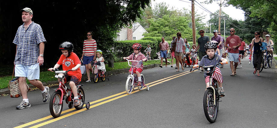 The annual July 4 Bike Parade rolls down Pequot Avenue Friday morning. Photo: Mike Lauterborn / Fairfield Citizen