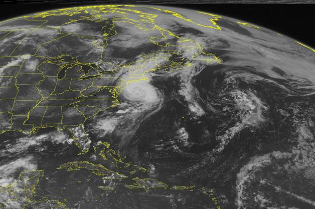 This NOAA satellite image taken Friday, July 4, 2014 at 01:45 PM EDT shows Hurricane Arthur moving up the eastern seaboard of the United States. As the storm continues it's northeastward track, it will slowly weaken and bring heavy rain and some thunderstorms to New York and much of eastern New England. A frontal boundary behind Arthur brings rain and thunderstorms to much of Florida.(AP Photo/Weather Underground) ORG XMIT: NY2 / Weather Underground